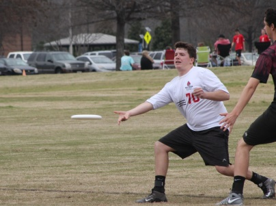 Sophomore Daniel Stephens flicks the disc to an open cutter in a bracket game against Kennesaw State in the Alabama tournament. Stephens played in 56 offensive points in the tournament. PHOTO BY: Will Hanna