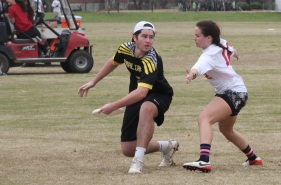 Freshman Audrey Williams attempts to block the disc in a bracket game against Kennesaw State. Williams played in one D point. PHOTO BY: Will Hanna
