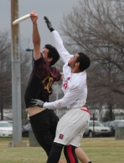 Freshman Jullian Thomas attempts to catch the disc against a Kennesaw State defender in a bracket game on Feb. 12. Thomas played in 55 points in the tournament. PHOTO BY: Will Hanna